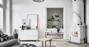 Patarimai, kaip derinti namų jaukumo simbolį židinį prie namų interjero