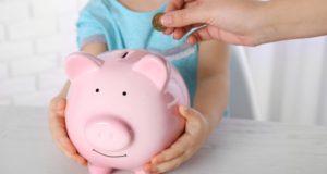 Menkas Lietuvos vaikų finansinis raštingumas: atsakomybė krenta švietimo sistemai ir tėvams